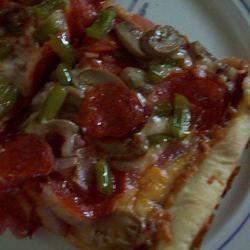 Пицца на тонком тесте с овощами